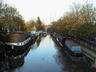 A lovely canal with canal boats. The canal boat cu...