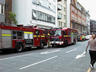The fire brigade blocks off the street and try to ...