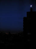Northeast Blackout - Moon over a dark city, New Yo...